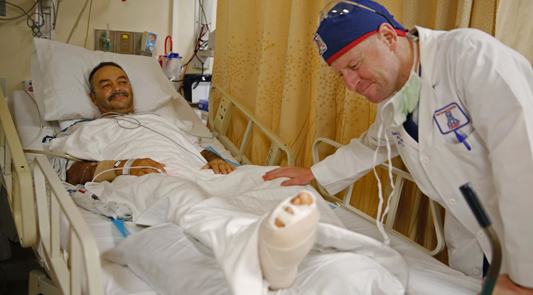 Dr. David Armstrong, an acknowledged expert on diabetic foot care, tends to a patient. (Photo courtesy of Southern Arizona Limb Salvage Alliance)